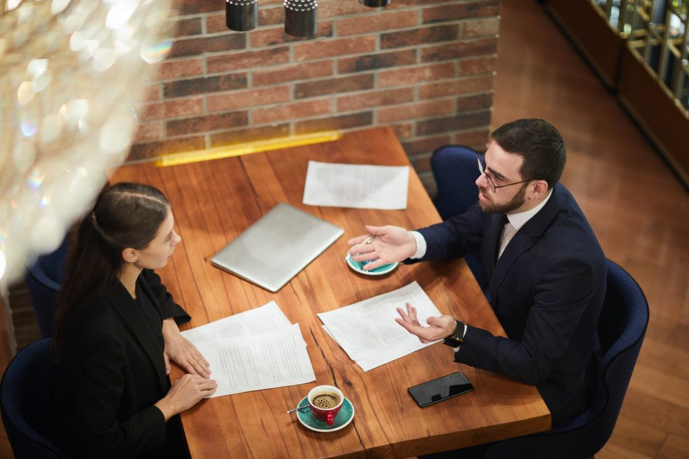 Professionals having a business meeting at a coffee shop